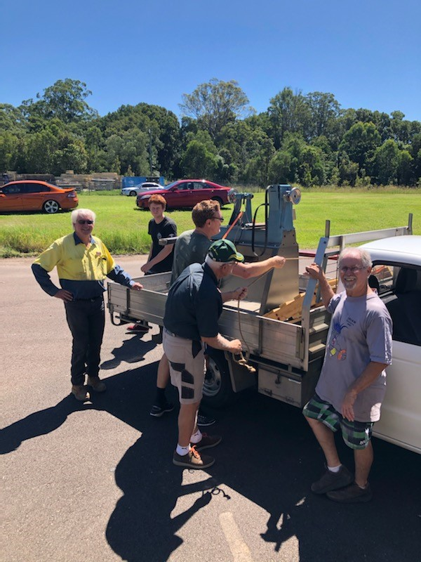 men-unloading-machines